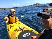 Sea kayak tour on the coast line near Tomakin
