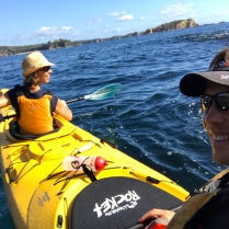 Sea kayak tour on the coast line near Tomakin